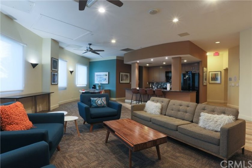 Newly remodeled community room features a full kitchen, pool table and large flat screen monitor for both private and community functions.