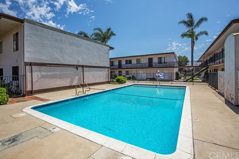 Walk by the inviting pool daily or jump in at your new condo!