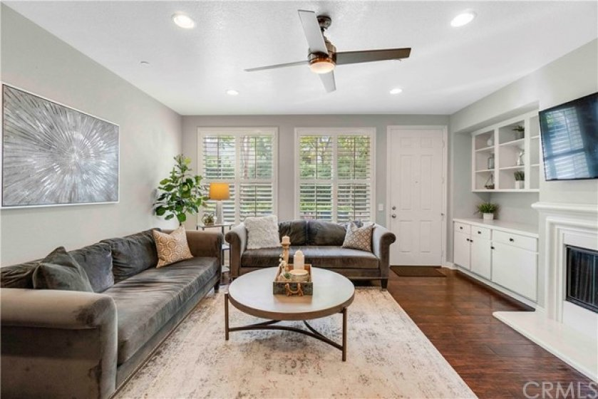 Spacious family room with fireplace and built-in cabinetry is perfect for entertaining or just relaxing with the family.