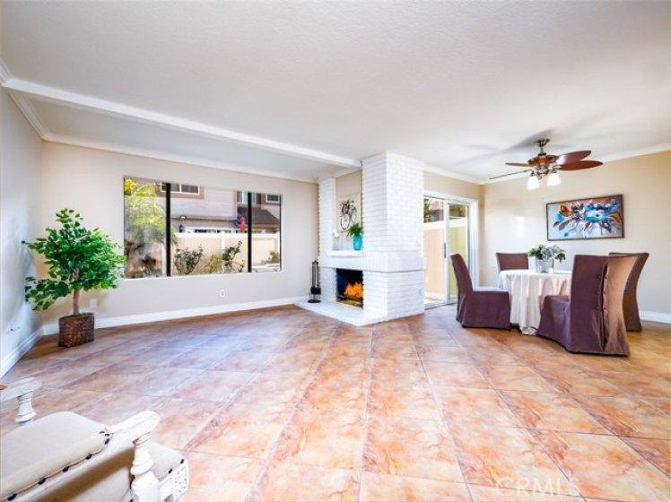 Living Room has Fireplace & view of Backyard