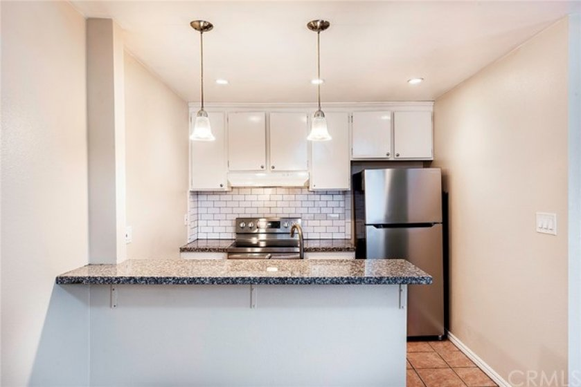 Beautiful subway tile backsplash, breakfast bar, open concept kitchen, granite countertops with stainless steal appliances in your new kitchen!