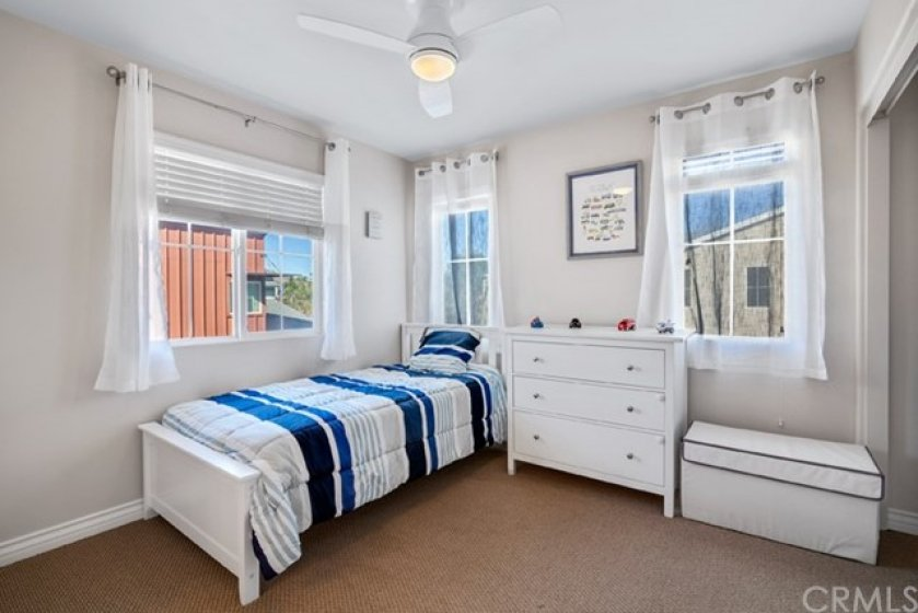 Spacious secondary bedroom with it's own bathroom.  Ceiling fan and several windows offering lots of natural sunlight.