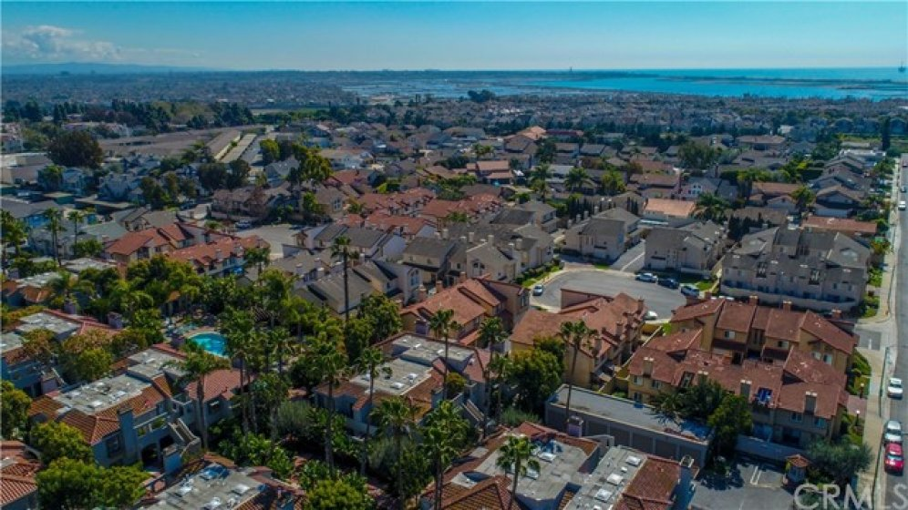 Aerial view of the community showing the close proximity to the ocean and Bolsa Chica wetlands