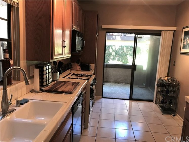 Kitchen Opens to second Patio for Barbequing and/or Gardening.