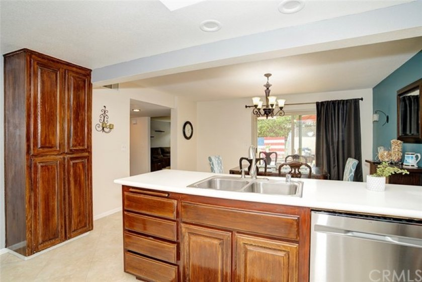 Kitchen is open to the dining room with view into the living room