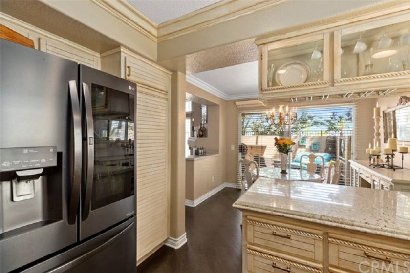 Glass cabinet doors custom pull out handles- Good sized pantry - View to backyard