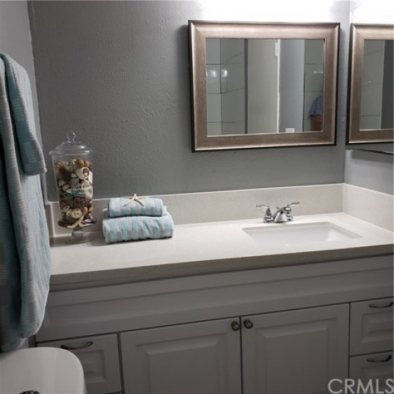 Master bathroom--notice large shower reflected in the mirror