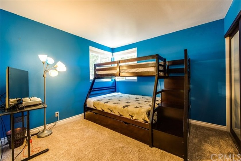 The second ensuite bedroom upstairs also has ample closet space and a private bath.