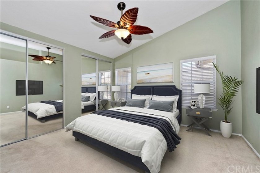 Very spacious master bedroom with dual closets, vaulted ceilings and an upgraded ceiling fan.  Virtually staged.