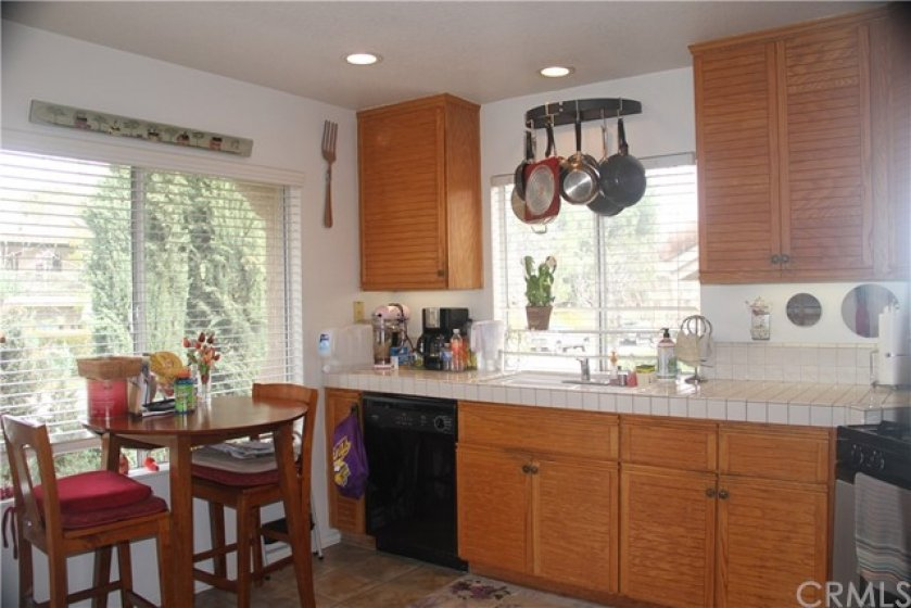Bright eat-in kitchen with direct access to covered patio.