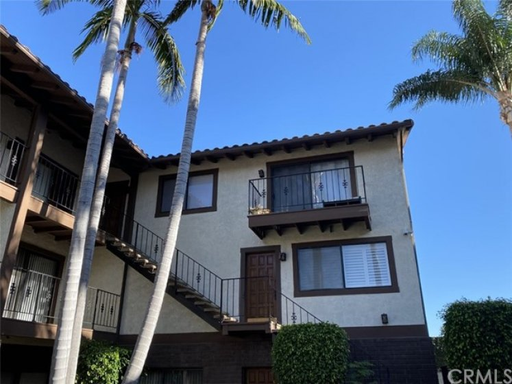 End unit on 3rd level with private balcony!