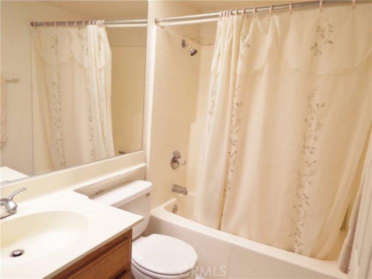 Guest bath with tile floors.