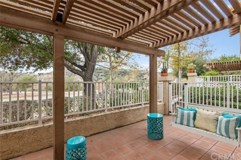 Freshly painted pergola and swing in the back patio a perfect place to enjoy your morning coffee and or view a beautiful sunset&#x3B; has an access gate to exit to the parkway and sidewalk.