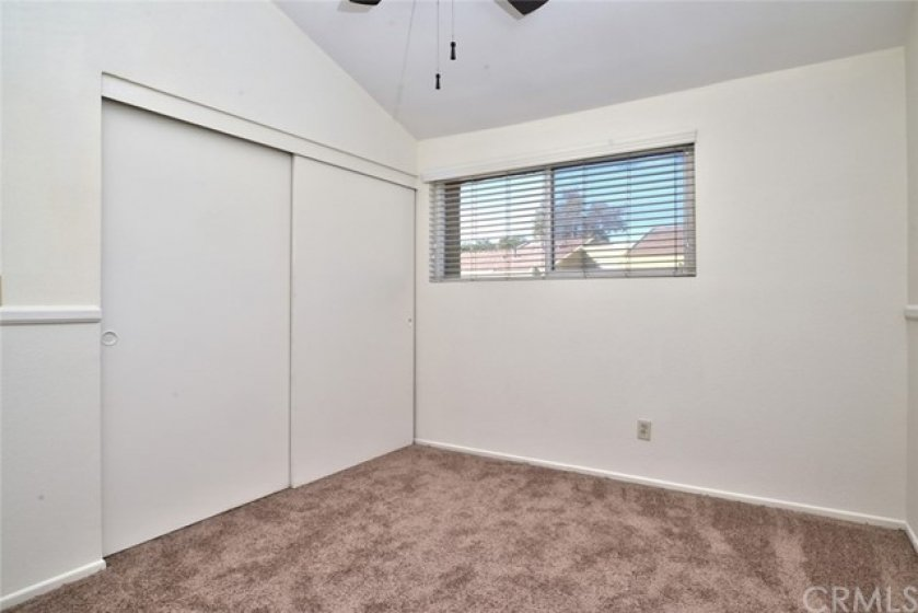 Another view of bedroom #4 showing the large wardrobe closet with plenty of storage space.