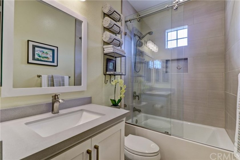 2nd Upstairs Full Bathroom - Completely Remodeled: Quartz Counters, New Cabinets, Super Tall Sliding Glass Door. Fan/Vent has Timer Controls.