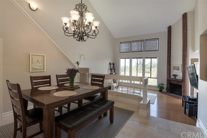 Dining room in beautiful and open floor plan. Vaulted ceilings.