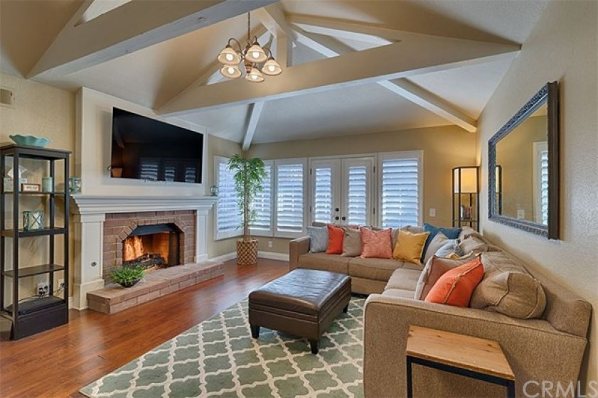 Gorgeous Living room, with great architecture, French doors, Fireplace.