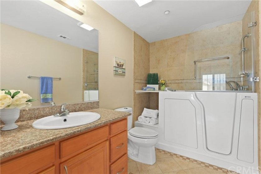 11-Master bathroom with high bed relaxing soak spa with massage Jacuzzi tub