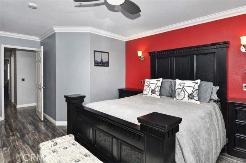 Master bedroom, laminate flooring, nice sconces.