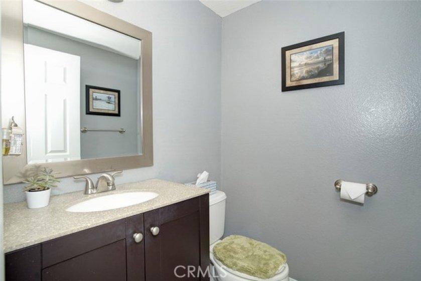 Downstairs powder bath with newer granite top vanity