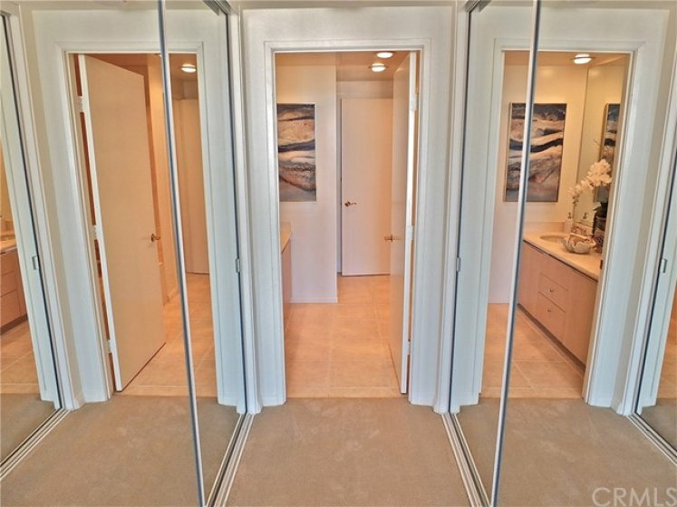 2 Mirrored wardrobe closets for with built-in cabinets and cedar lined walls with keep your organized and keep your closets looking fantastic.
