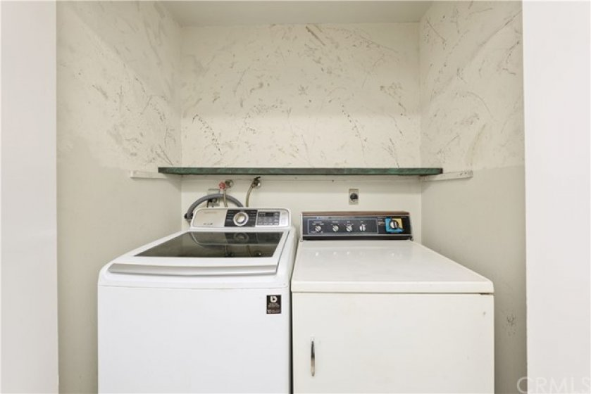 Laundry area located downstairs located in the half bath