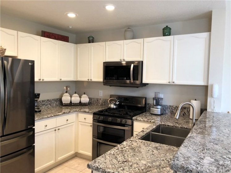 Beautiful Granite Counters and Near New Stainless Appliances