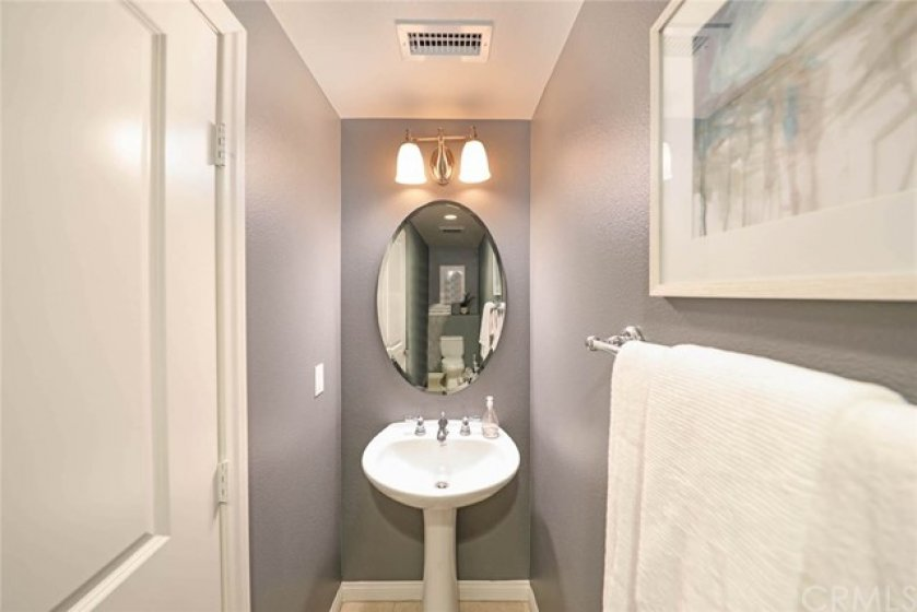 Downstairs powder bath is both convenient and tastefully decorated for your guests.