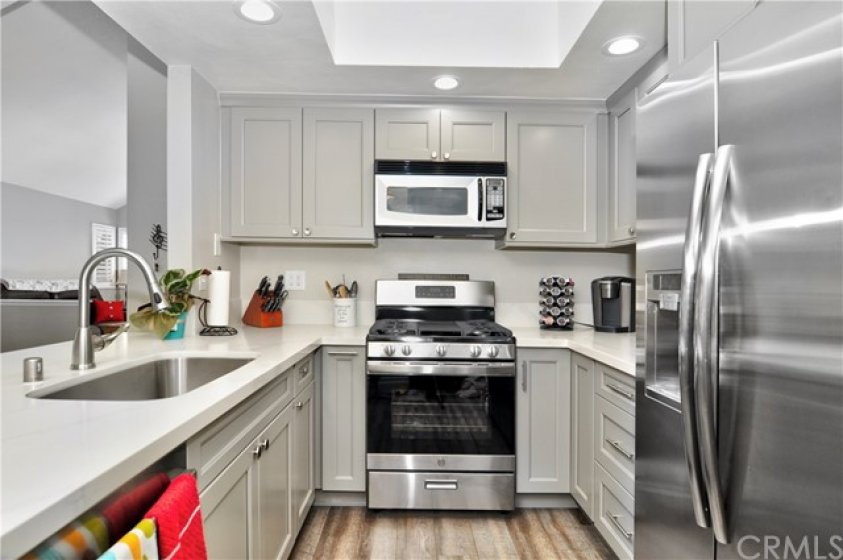 Kitchen with brand new gas stove/oven with center griddle feature.