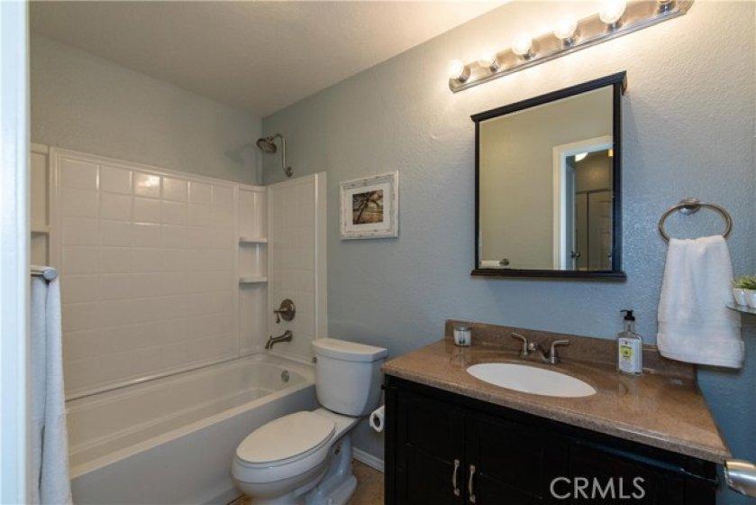 Secondary bath with granite countertop