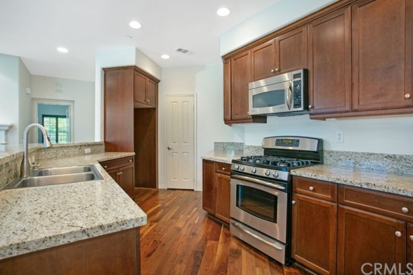 Granite counters, stainless steel appliances and a walk in pantry.