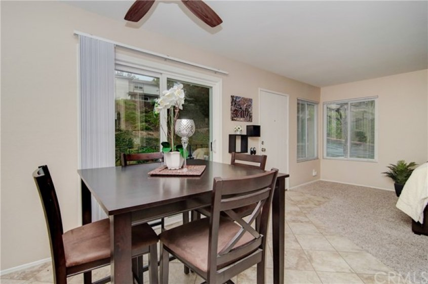 DINING AREA WITH SLIDING DOOR LEADING TO THE PATIO AREA.