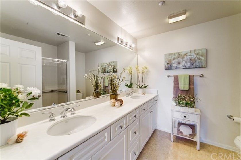 Large master bathroom with dual vanities and walk-in shower