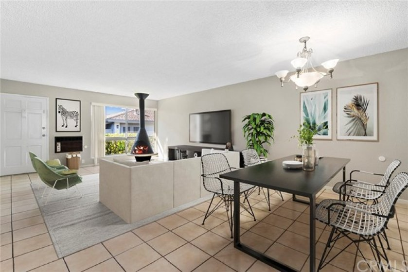 Dining area and family room virtually staged with furniture.