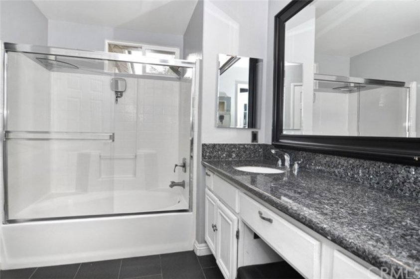 Over sized tub and shower, glass enclosure.