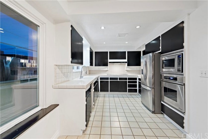 spacious kitchen with stainless appliance & ocean view
