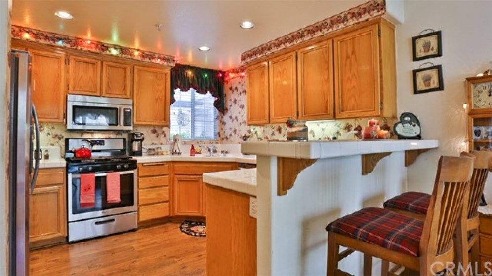 Kitchen opens to family room and features new stainless steel appliances.