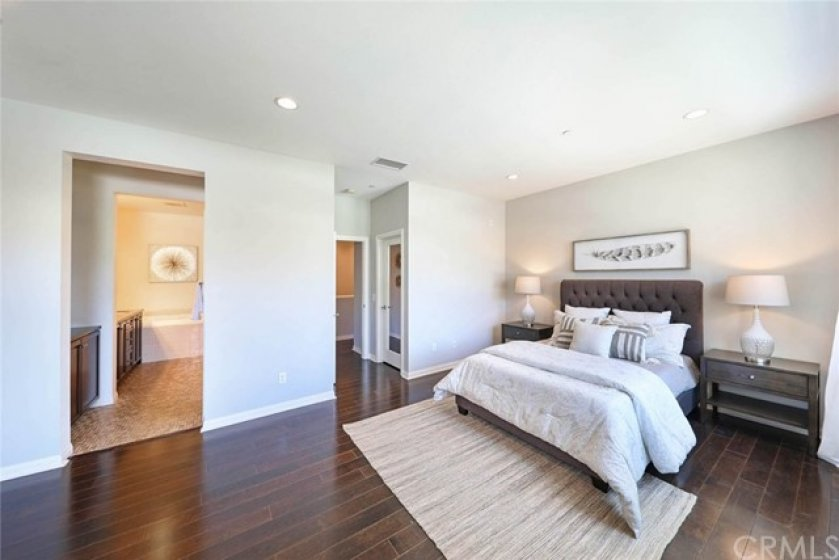 Relaxing, oversized bedroom suite is spacious and inviting at the end of a long day.