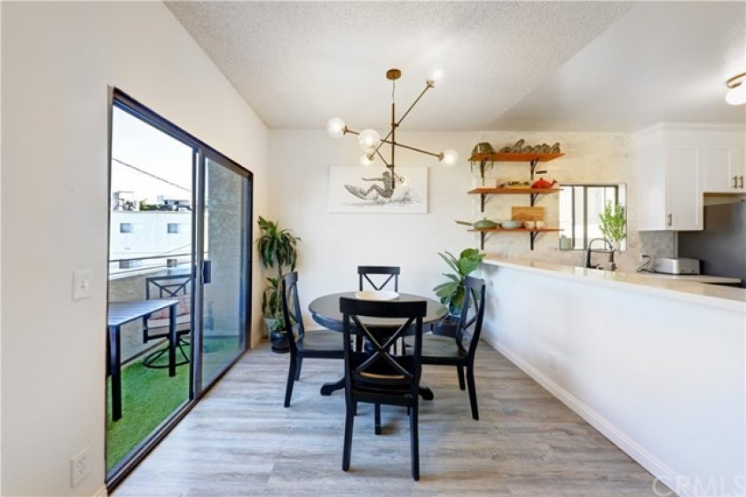 Kitchen, Dining area and balcony