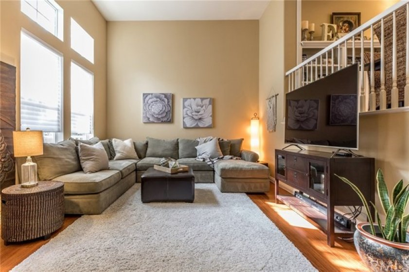 Warm and inviting living room with cathedral ceilings and wonderful natural light