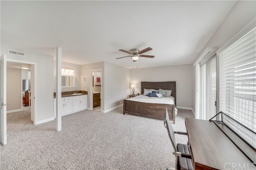 The owner's suite is quite spacious. New carpet just installed in upstairs. This room has a private balcony and plenty of closet space.