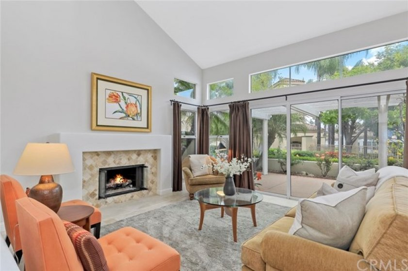 Gorgeous Living Room with Travertine Fireplace and Vaulted Ceilings