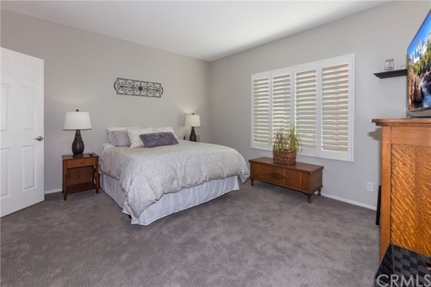 Equally large owner suite with two walk-in closets, en quite dual sink master bath with shower over tub.  Plantation shutters throughout home