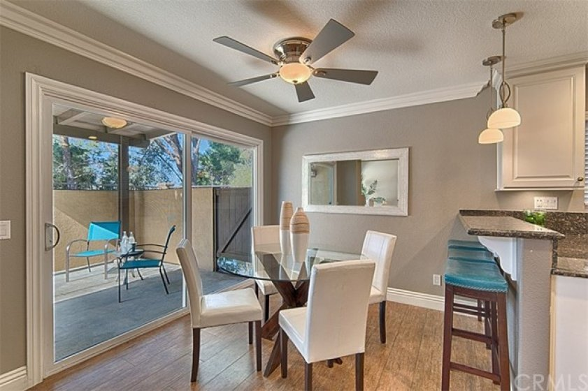 Formal Dining room looking out to the relaxing & private backyard.