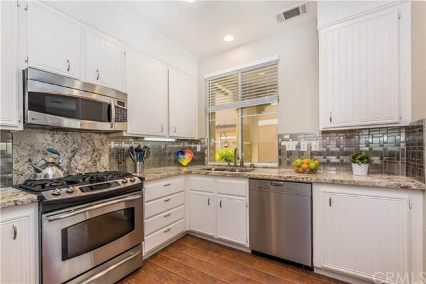 Remodeled kitchen included upgraded leathered granite counters and a contemporary tile backsplash!