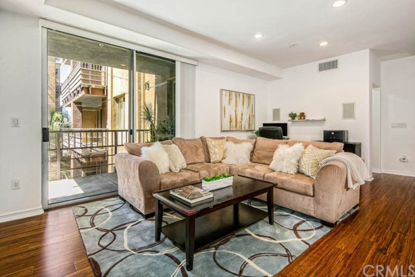Open floor plan GREAT ROOM concept has endless possibilities.  Living room has large sliding glass doors that open up to a large balcony overlooking the serene garden.  This is a very quiet and relaxing unit.