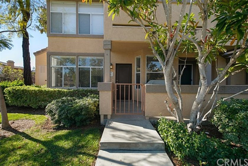 Single-level, end unit with gated patio entry.