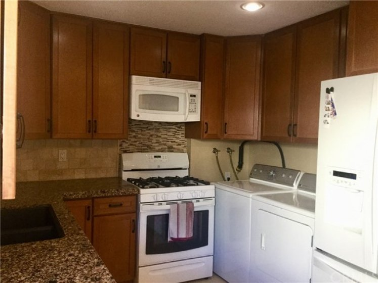 Washer, dryer and refrigerator included