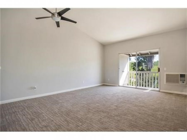 No carpet.  Replaced with wood flooring in previous picture of  current wood flooring.
