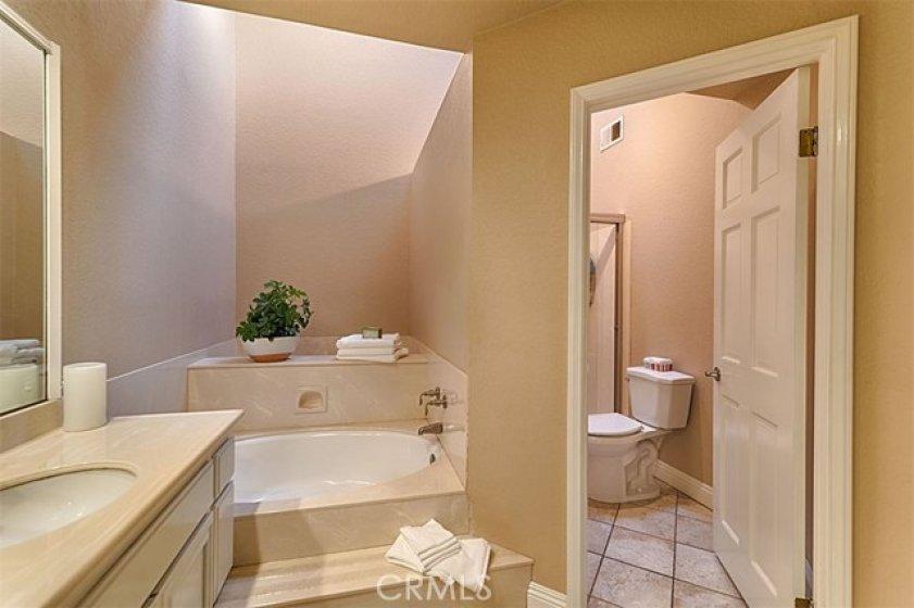 Tile flooring, light and bright Master Bathroom.